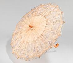Parasol    Date:      1920–29  Culture:      American  Medium:      silk, wood, metal, plastic, leather