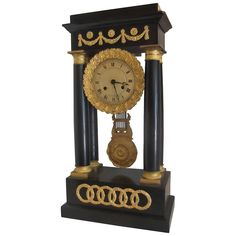 French 1st Empire Ebonzed Portico Clock with Ormolu Mounts | From a unique collection of antique and modern clocks at https://www.1stdibs.com/furniture/decorative-objects/clocks/
