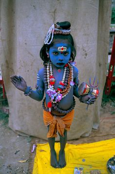Child dressed as Krishna