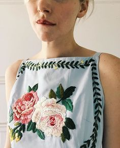 A vintage shift dress embroidered by Tessa Perlow.