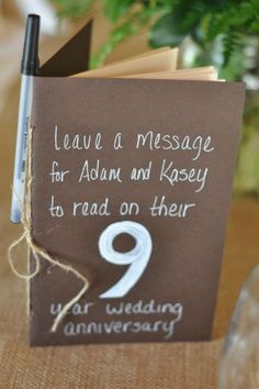 Super cute idea to have table numbers be Moleskin notebooks that everyone writes wishes in - then the bride and groom read the wishes on that anniversary!