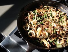 The green bean casserole was concocted in 1955 by Campbell's Kitchen head Dorcas Reilly. The recipe, which originally called for four cups of cooked, cut green beans, one can of cream of mushroom soup, some milk, some soy sauce, a dash of pepper and a canned French-fried onion, landed Reilly a spot in the Inventors Hall of Fame in 2002. I'm not trying to reinvent this classic yet again, I'm just trying to make it even…classic-er while making it taste more like the stuff that's supposed to be…