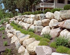 At Boulder Images we design boulder retaining walls that fit into the natural landscape of your backyard.