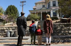 Don Draper takes his kids to the home/whorehouse in which he grew up.