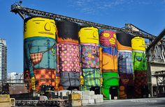 Twin brothers and Brazilian artists Octavio and Gustavo Pandolfo, known together as Os Gemeos, turn 70 ft silos in Vancouver into colorful giants #art #graffiti #repurpose