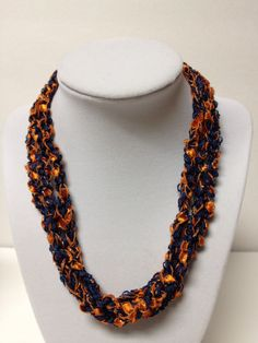 Check my blog: centraltexascrafter.com or direct link below. Want the look of beads but enjoy the light-weight feel of yarn? Handcrafted, orange and blue, glittery necklace, suitable for any Broncos football game!