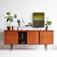 "↠ cadence hays ↞ on Instagram: ""happy friday! restored - one vintage teak credenza (it's a biiiig guy). beautiful painting in pic by the ever-talented @ryan.loeppky! credenza has 5 side drawers and 2 sliding doors with inner shelving. dimensions are: 72 inches long, 20 inches wide, 29.5 inches tall. ✨ #restoration"""