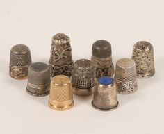 Nine antique silver and gold sewing thimbles