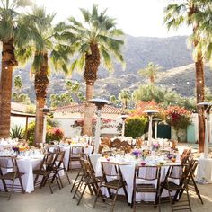 Outdoor palm tree lined reception space | Alders Photography | www.theknot.com