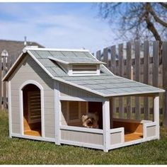 Lucky dog! The Outback Savannah Dog House looks like a real house,  with a little chimney and dormer. It's as comfortable and roomy as the  real thing too, complete with a covered porch to while away lazy summer  afternoons watching everyone else work. This sturdy house is constructed  of solid fir for strength and weather-loving durability, protected by a  handsome tiled gable roof. Two built-in vents keep your dog cool and  comfortable when it's hot, while keeping cold and wet winds out.