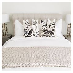 This guest room is upstairs in its own little wing, so we designate it specifically for our parents when they come to visit! It has a pretty view of the backyard and part of the canyon, and it sits next to a comfy little family room, which I think adds to the secluded cozy spot! We are all about neutral palettes, and these floral pillows are my absolute favorite...they aren't too girly for the men, right?  - #LTKathomewith @laurenscruggs | Get ready-to-shop #LTKhome details with…