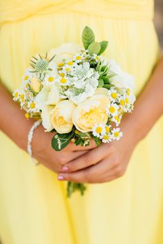 yellow bouquet, photo by BrittRene Photography http://ruffledblog.com/california-country-chic-wedding #weddingbouquet #flowers