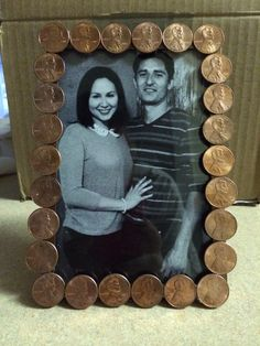 Seven Year Anniversary Gift for the Hubby! Copper is one of the gifts for the seven year anniversary so I glued Pennies (first cleaned in a half a cup of vinegar and teaspoon of salt; makes them shiny) and then I used a gluegun and glued them to a dollar tree Picture Frame. Bonus if you're able to find the years in pennies that matched the years of when you met and married.