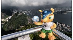 RIO DE JANEIRO, BRAZIL - JUNE 28: (EDITORS NOTE, THIS IMAGES WAS CREATED WITH THE USE OF DIGITAL FILTERS.) FIFA World Cup 2014 mascot Fuleco, is pictured on Sugarloaf mountain whilst on tour around Rio on June 28, 2013 in Rio de Janeiro, Brazil. (Photo by Stuart Franklin - FIFA/FIFA via Getty Images)