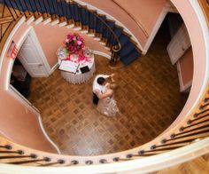 Couple sharing a moment at the bottom of the grand stair case at Brantwyn Mansion.  www.dupontcountryclub.com/weddings