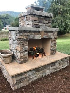Want to see an amazing outdoor fireplace built entirely by a DIY homeowner? Read about the work this Georgia homeowner put into this gorgeous Pima II fireplace. He used a DIY construction plan and didn't have to guess how to build it. Outdoor Fireplace Plans, Outdoor Stone Fireplaces, Outdoor Fireplace Designs, Backyard Fireplace, Fire Pit Backyard, Outdoor Wood Burning Fireplace, Fireplace Ideas, Outside Fireplace, Outdoor Kitchen Plans