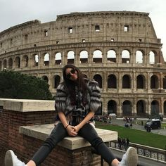 """model off duty at the Colosseum in Rome"""
