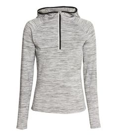 Light grey melange, fitted running top in fast-drying, functional fabric with a brushed thermal inside. Hood, zip at front, key pocket with zip at one side of  back & reflective details. Rounded hem. | H&M Sport