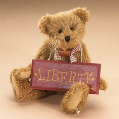 This vintage cutie is a true blue America-lovin' bear! From the tip of his rust colored ears to the tip of his fabric-patched paw pads Patrick Henry is sure to inspire liberty in everyone he meets! Just check out the wooden sign he carries...inscripted w