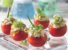chicken salad in medium tomato halves. Great Recipe I sent via email.