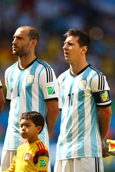 Lionel Messi (R) and Pablo Zabaleta of Argentina look on prior to the 2014 FIFA World Cup Brazil Quarter Final match between Argentina and B...