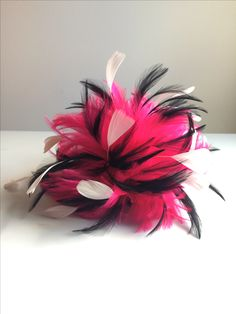 Hot pink, black and white feather fascinator