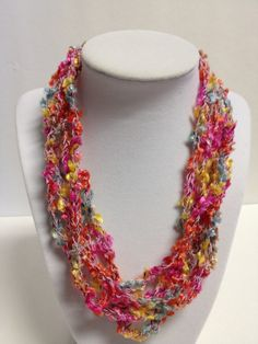 "Check my blog: centraltexascrafter.com or direct link below. Want the look of beads but enjoy the light-weight feel of yarn?  Handcrafted, beautiful and very soft, necklace with vibrant colors. Length can be adjusted from 18"" to 24"" with ease. No metal, no clasps - easy to put on and wear. You'll get so many comments on your ""beads"" - this unique necklace will garner you many compliments!"