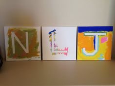 Some finished products from our Rainbow Art Party. The kids painted over tape. The letter is the initial to their first names.