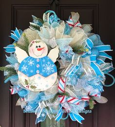 A personal favorite from my Etsy shop https://www.etsy.com/listing/547190388/snowman-wreath-snow-angel-wreath-winter