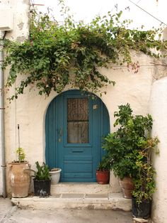 Blue door in Santorini Greece
