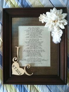 Framed wedding song for a burlap and lace themed wedding. All from Hobby Lobby for about $35. 11x14 frame matted to 8x10. Printed wedding song lyrics on resume paper to insert in frame. Pre-made wooden letters and heart. Metal stickers for numbers and canvas/lace flowers from scrapbooking area. Large burlap flower from floral area. Clear spray paint for wood pieces. Hot glue to frame. Easy peasy.