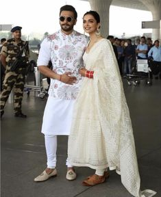 Stunning Airport Looks Newly weds heartthrobs Deepika Padukone and Ranveer Singh scintillate in ethereal white palette as they head out of Mumbai for their first wedding reception - to be held in Bengaluru on November, We heart! Wedding Dresses Men Indian, Wedding Dress Men, Celebrity Wedding Dresses, Men Kurta Wedding, Engagement Dress For Groom, Wedding Sherwani, Celebrity Weddings, Indian Dresses, Mens Indian Wear