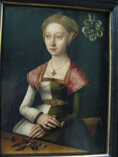 Portrait of a woman holding a carnation, by Jacob Claesz, called Jacob van Utrecht. Between 1520 and 1524, northern Germany. Held in the Louvre, Paris. Note the structural similarities to Anne of Cleves's hat.