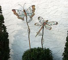 """Whether real or """"faux"""" butterflies and dragonflies complete any garden."""