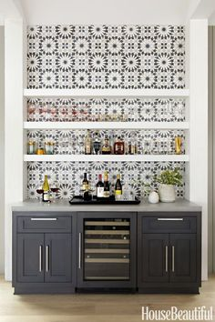 Opt for graphic tiles: Cement tiles from Ann Sacks, installed behind the Thermador gas cooktop and the dry bar beside the dining table, add the right amount of focal-point pattern. Click through for more amazing photos of this farmhouse kitchen. Home Bar Designs, Home Design, Interior Design, Modern Interior, Wet Bar Designs, Modern Decor, Modern Farmhouse Style, Deco Design, Wall Design