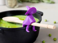 Whether you're stirring up a bubbling potion in a giant black iron cauldron far out in a dreary haunted forest or just stirring up something quick and easy on the stovetop at home, keep your spoon safely up and off surfaces with this cool new witch spoon holder and steam releaser.