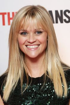 This straight, layered haircut flatters Reese Witherspoon's classic heart-shaped face. Her wispy bangs balance her wider forehead with her narrow chin.