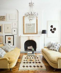 ali-cayne-living-room-sofas-eclectic-art-walls