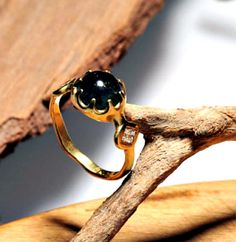 Alternative engagement ring. Woman gold ring with stone. Gold