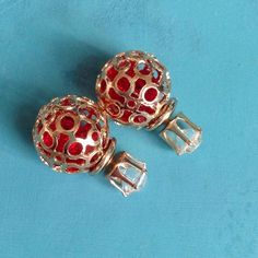Brand New Double Sided Earrings Gold tone ball filled with red rhinestone pieces. Very pretty. O.S.S Jewelry Earrings