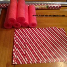 Large Christmas candy decorations - pool noodles, cellophane and printed tissue paper.
