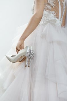 Each shoe and bag showcases bespoke embellishment and exceptional attention to detail.
