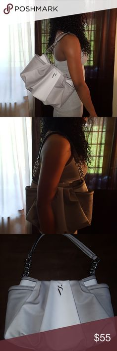 Beautiful Simply Vera by Vera Wang shoulder bag Beautiful new with tags gray leather Simply Vera shoulder bag. By Vera Wang. Not to big not to small. Vera Wang Bags Shoulder Bags