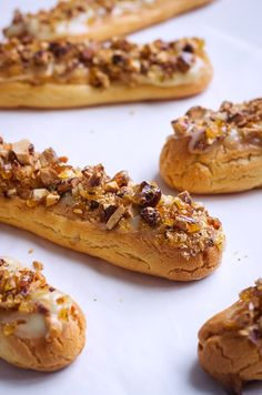 Delicious white chocolate eclairs topped with crunchy caramelized almonds — So refined, elegant, and easy to make, these eclairs make for a cozy afternoon treat, especially perfect with a mug of ho…