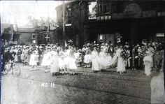 Halliwell real photo postcard showing a procession at Radcliffe