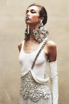 Cross-body single suspender is killing it     Karlie Kloss by Angelo Pennetta in UK Vogue May 2012