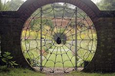 Ornamental wrought iron Spider's Web gate by Eric Stevenson of Wroxham, 1936