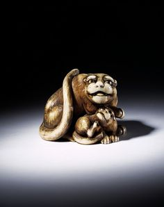 Netsuke        Place of origin:        Japan (made)      Date:        ca. 1775-1825 (made)      Artist/Maker:        Tomotada (maker)      Materials and Techniques:        Carved ivory      Credit Line:        Dresden Bequest      Museum number:        A.49-1915