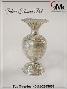 Meta Krafts Flower Pots are a symbol of exquisiteness, elegance and strength. Being a reputed Manufacturer, Exporter and Supplier, we manufacture Flower Pots using superior grade Silver and finish them with beautiful designs. These are ideal for Pooja ghar, bedroom, Drawing room, & offices. #meta #jewel #dazzling #fruit #flower #pot #silver #plate #glass #bowl #thali #picture #frame #jewellery #box #kalash #roses #pooja #jali #tray #basket #jar #barni #table #watch #candle #stand #corporate…