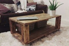 Rustic coffee table with chunky legs and practical wheels or wooden blocks. Full lower deck is perfect for baskets, boxes and general storage. This table has a really aged industrial look, its definitely an eye-catcher for your living room! - Dimensions are 90cm x 50cm x 40cm  - Table top is sanded & waxed twice for durability - Table is lightly stained in medium oak - 4x practical 75mm rubber wheels at each corner (2x standard, 2x brake) or 10cm wooden block legs. - Made to order within…